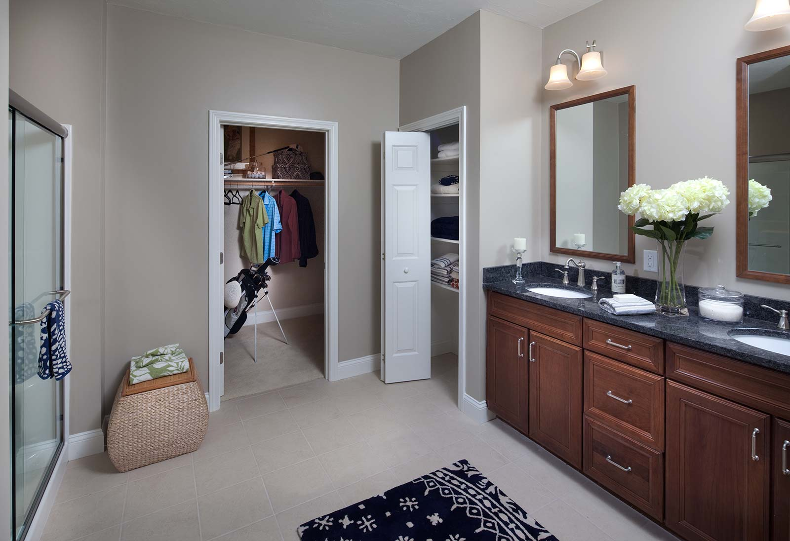 Master Bath With Just Shower double sinks, a walk-in closet, linen closet and large shower are